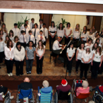 From 2009, I'm surrounded by young singers performing Christmas Carols for the folks at Shorehaven Tower in Oconomowoc.